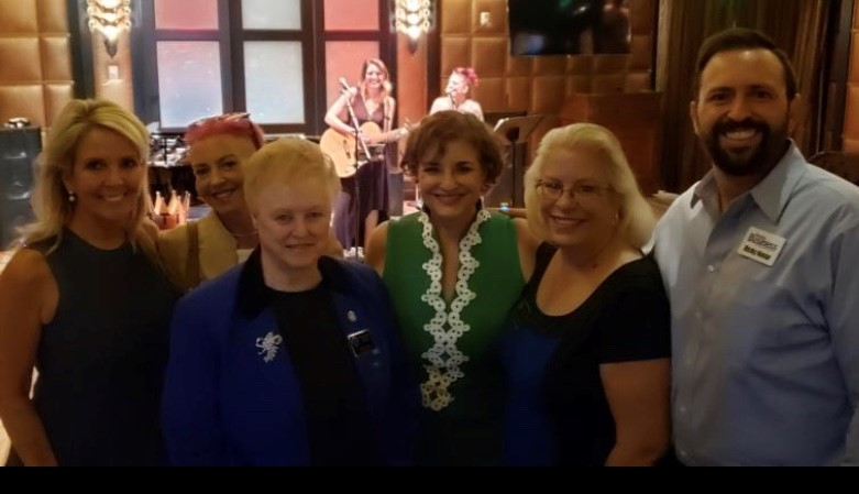 Carrie Simpson, at the newly renovated Stirling Club, pictured with (L to R) Sandra Roche (Roche Construction), June Beland (Women's Chamber), Ruth Furman (ImageWords), Marie Scrofani (Women's Chamber) and Ricky Navar (Nevada Business Magazine)