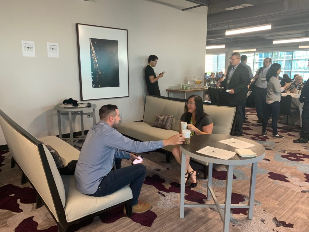 Tracie Orisko chats with Solar Winds Partners at the Managed Sales Pros coffee space.